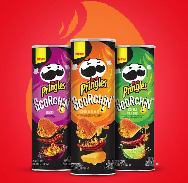 pringles scorhin spicy chip line, purple bbq flavor can, orange cheddar flavor can, green chili  lime flavor can