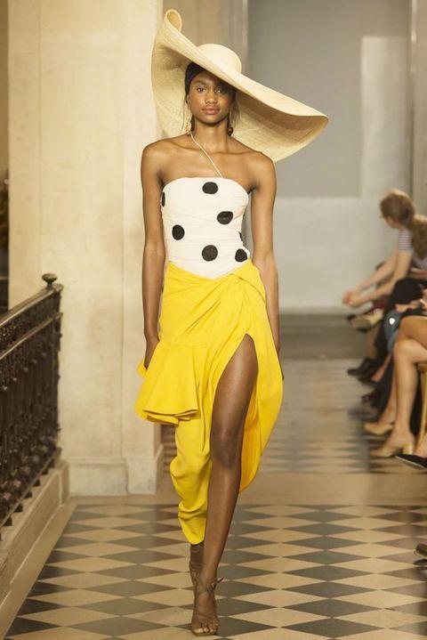 Fashion model, Fashion, Fashion show, Clothing, Runway, Yellow, Haute couture, Shoulder, Waist, Dress,