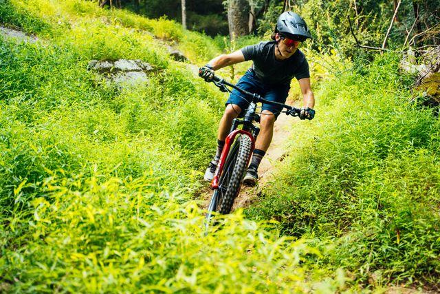 male mountain biker riding trail