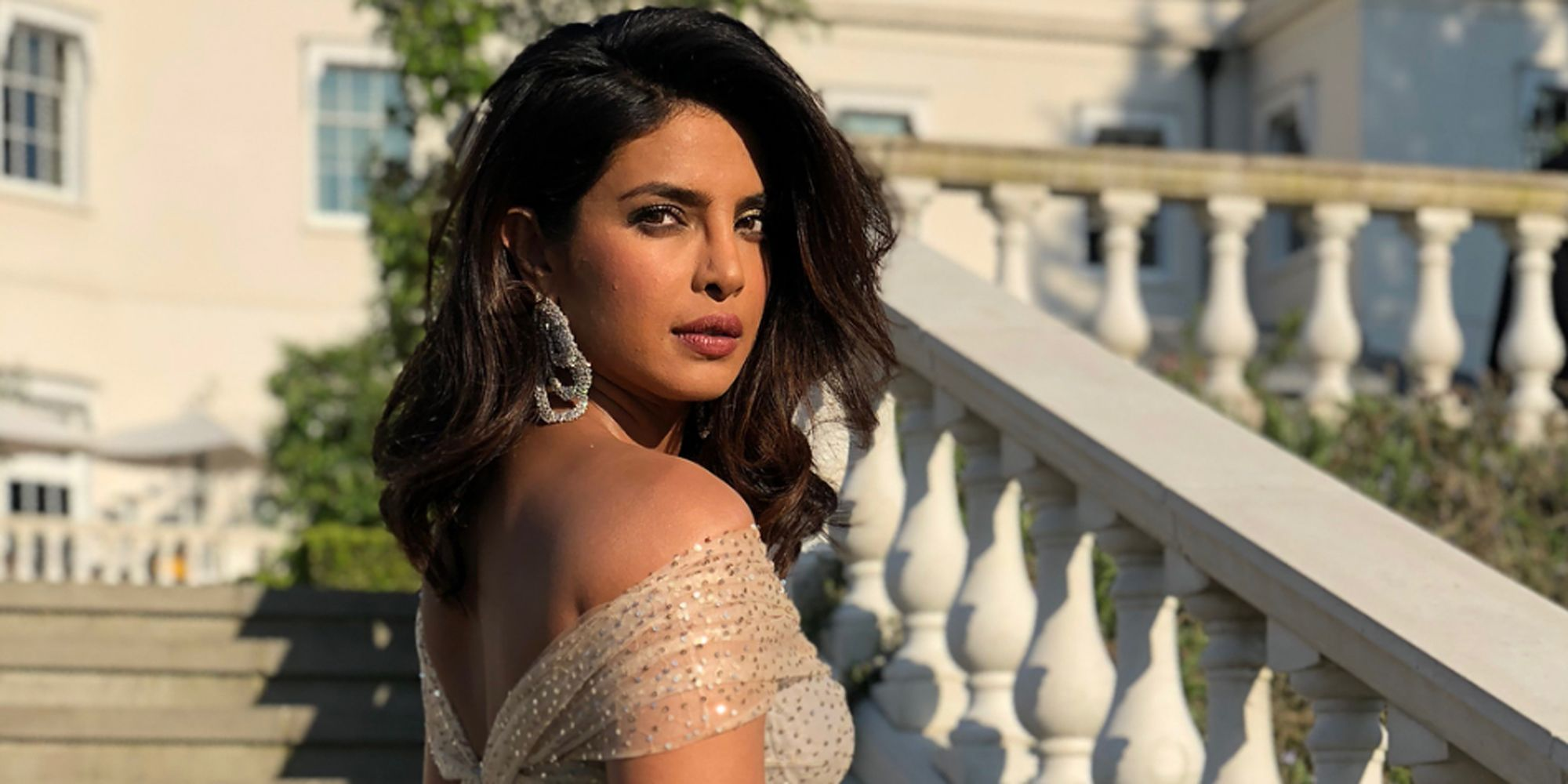 5c0435f72251 Priyanka Chopra Wears Dior Princess Dress for Meghan Markle and Prince  Harry s Reception - Priyanka Royal Wedding Outfit Change