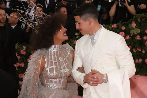 priyanka chopra and nick jonas smiling at each other on the red carpet for the 2019 met gala celebrating camp notes on fashion