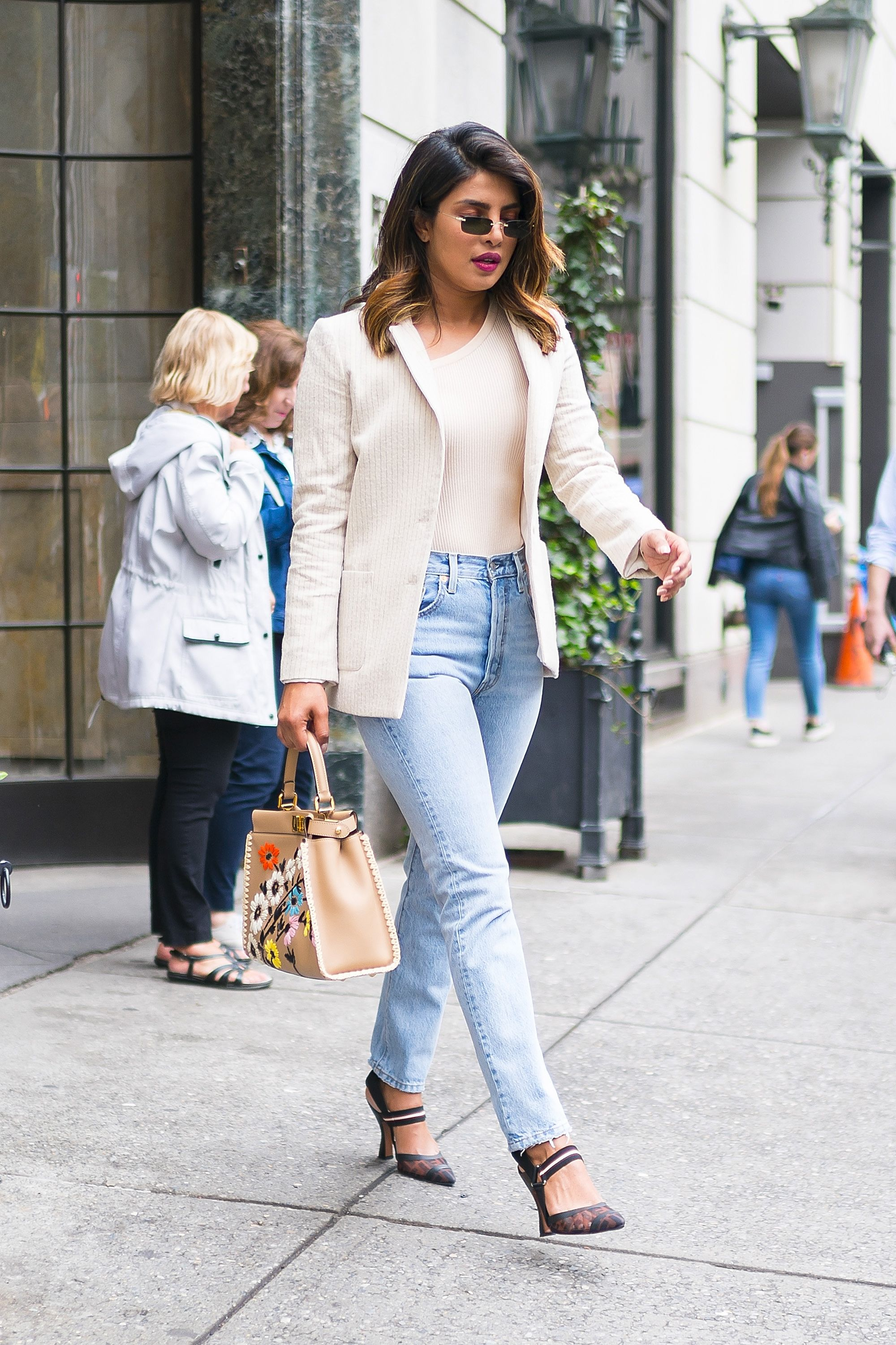Priyanka Chopra After spending two days on your couch with Netflix, you're ready to rejoin the world a.k.a. your SO or friends for a day out. Stay comfortable with jeans and a plain top, but elevate your basics with pumps and a blazer.