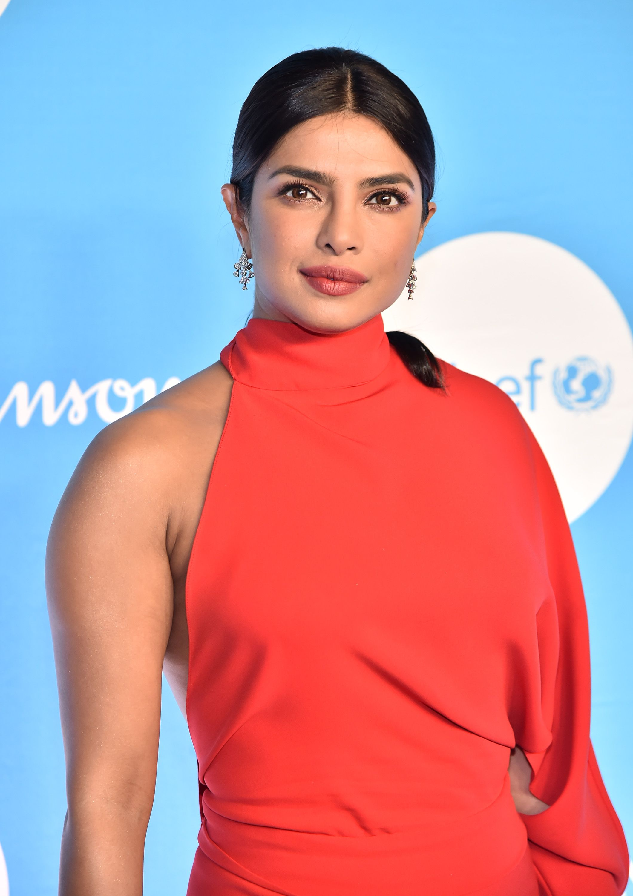 Priyanka Chopra Stunned in an Asymmetrical, Christmas Red Gown at UNICEF's Snowflake Ball
