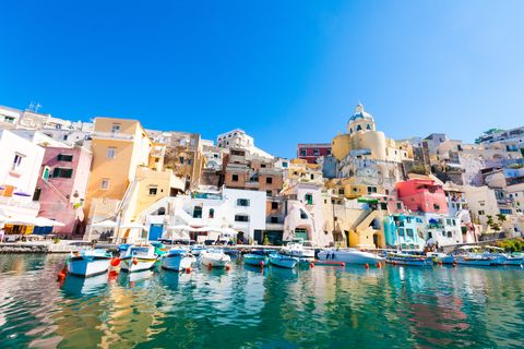 Blue, Town, Harbor, Sky, Human settlement, Vacation, Tourism, Azure, Sea, Waterway,