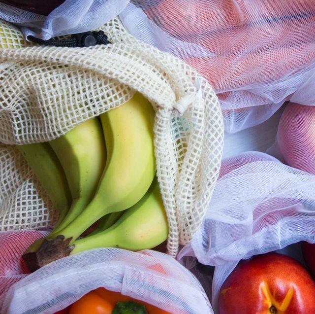 apples orange bananas in reusable produce bags