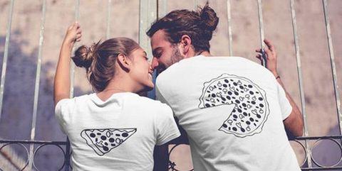 couple wearing matching pizza shirt