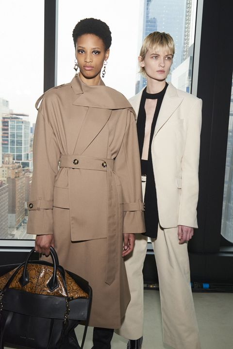 Trench coat, Clothing, Overcoat, Coat, Fashion, Outerwear, Fashion design, Pantsuit, Uniform, Beige,
