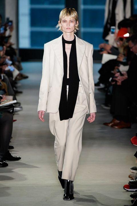 Fashion, Fashion model, Runway, Fashion show, Clothing, Suit, Formal wear, Outerwear, Blazer, Human,