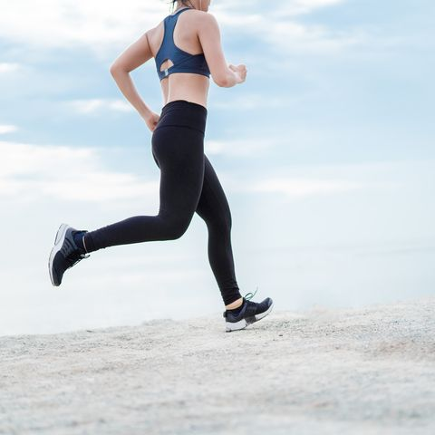 professional runner jogging woman fitness workout outdoor at the beach on sunset for healthy lifestyle her starting challenge cardio training, sporty marathon concept