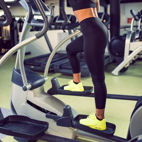 profile of young smiling woman exercising in health club