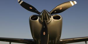 Propellers of Cirrus SR-22 with Synergy Aviation Piper PA-28 Cherokees and Cessna 152s parked behind