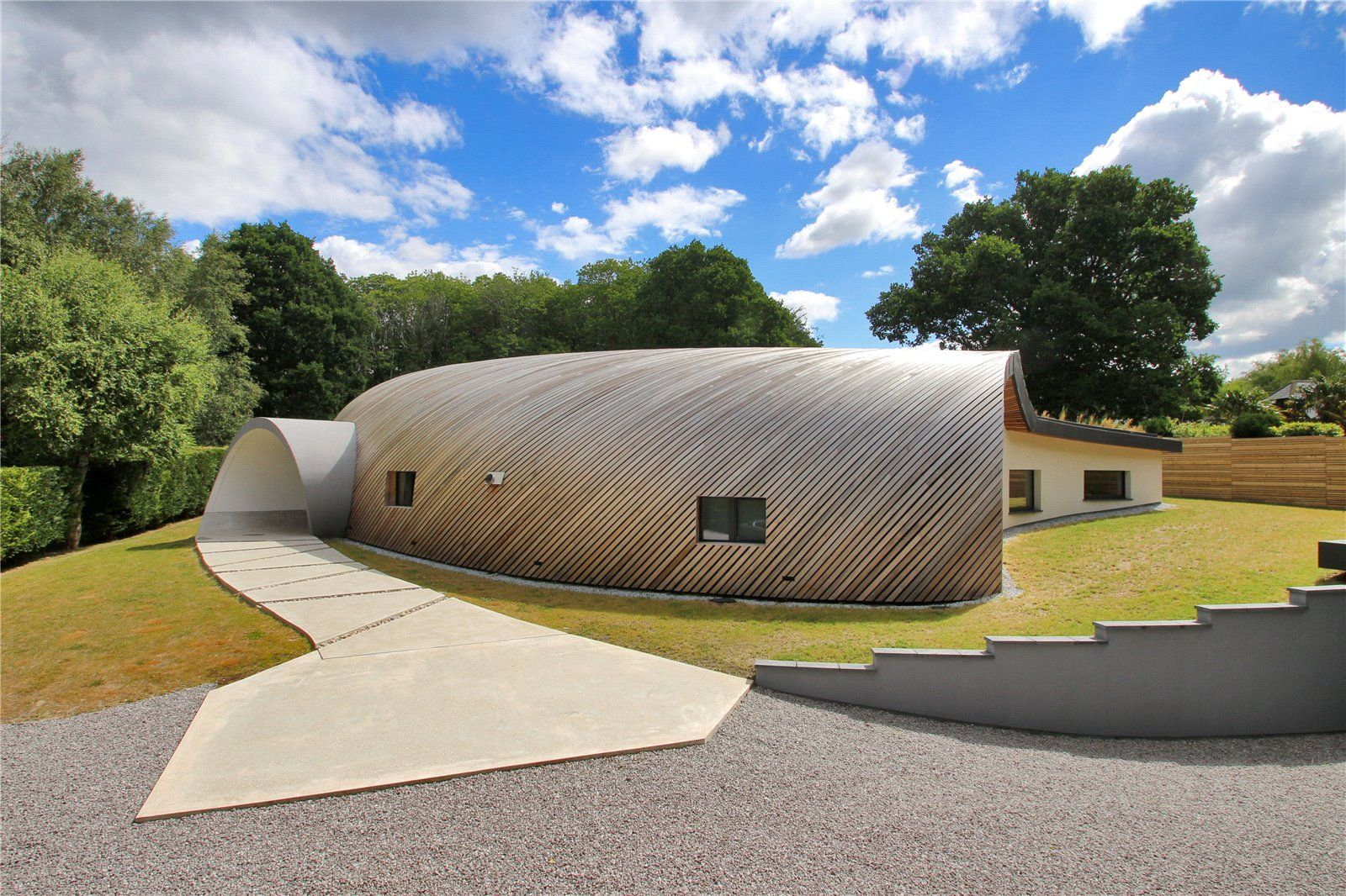 Peek inside this contemporary curved house in West Sussex