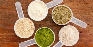 Five different scoops of protein powders