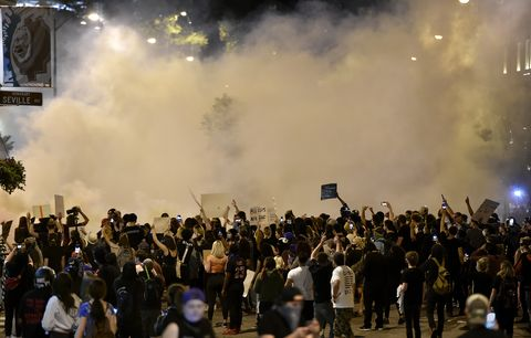 a large cloud of tear gas hovers over protesters gathered at wyandotte street and w 47th street thousands of people gathered saturday, may 30, 2020, at the country club plaza for a second night of protests against police brutality and the death of george floyd