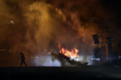 a police suv was vandalized then set on fire during the protest thousands of people gathered saturday, may 30, 2020, at the country club plaza for a second night of protests against police brutality and the death of george floyd