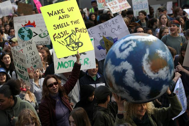 students walk out of school as part of worldwide youth climate strike