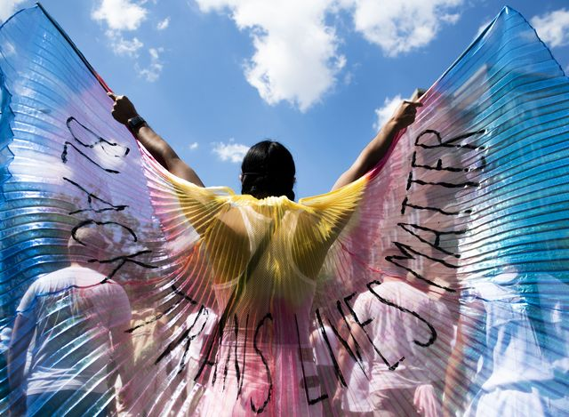a protestor displays wings while marching on on june 14, 2020 in the brooklyn borough of new york city protests continue in locations all around the country in the wake of the death of george floyd while in minneapolis police custody on may 25