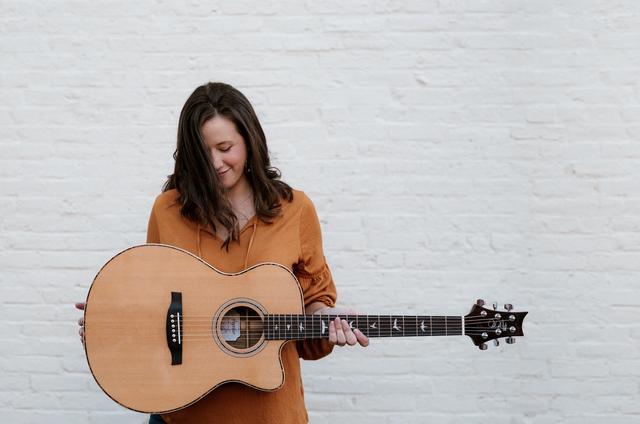 woman playing prs guitar
