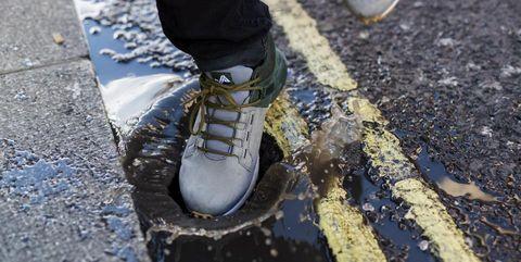 Footwear, Shoe, Jeans, Road surface, Asphalt, Reflection, Plimsoll shoe, Leg, Sidewalk, Shadow,