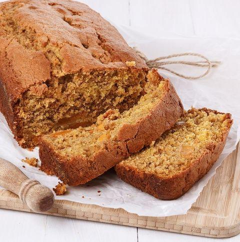 Pumpkin bread loaf over white wooden background