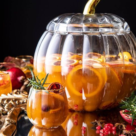 thanksgiving sangria with big pumpkin container