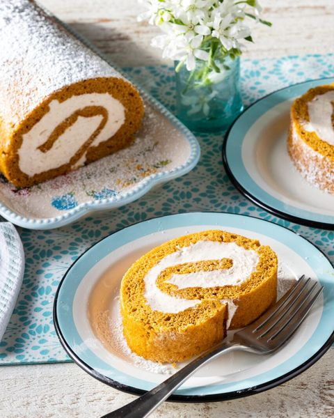 pumpkin roll with slice on plate and fork