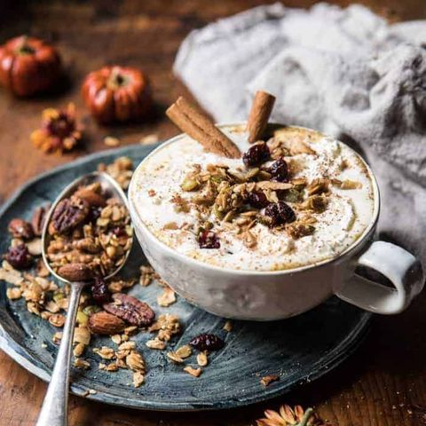 spice oatmeal latte with granola and cinnamon sticks