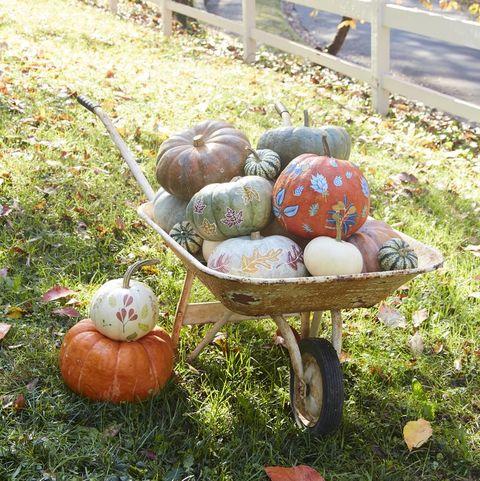 pumpkins painted with leaf motifs