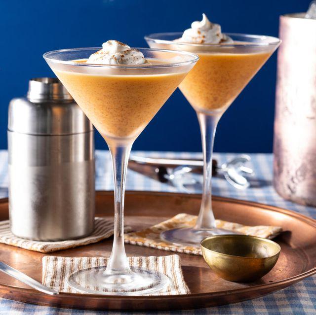 pumpkin pie martini with frozen whipped cream and pumpkin pie spice