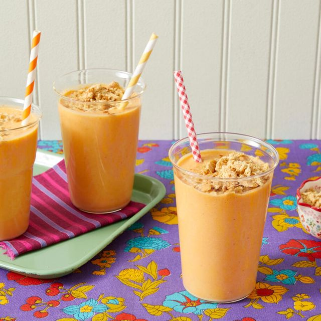 pumpkin smoothie recipe with crushed graham crackers on purple flower surface