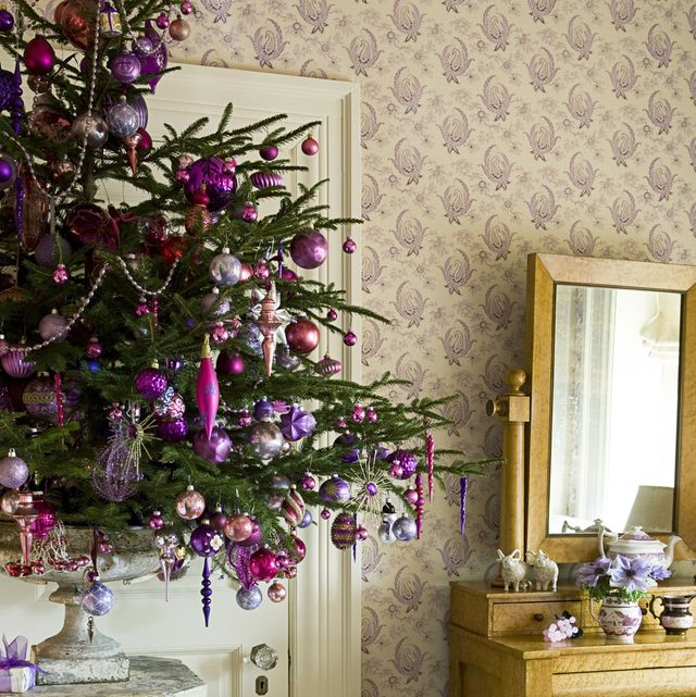 purple christmas decorations in traditional room