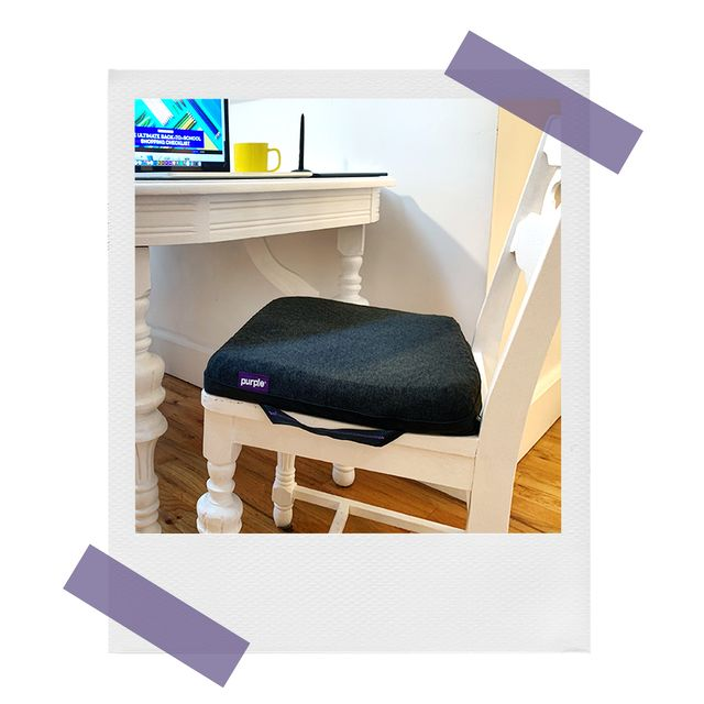 purple royal cushion on wooden chair at kitchen table