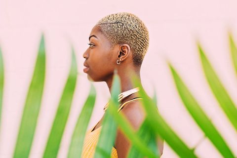 Hair, Skin, Green, Hairstyle, Beauty, Yellow, Ear, Close-up, Grass, Cornrows,