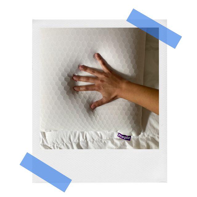 melanie's hand on top of purple harmony pillow