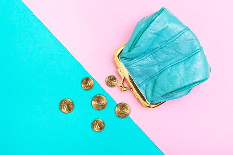 Purse for coins. A leather purse, wallet on a Geometric pink and turquoise background. Trend colors.