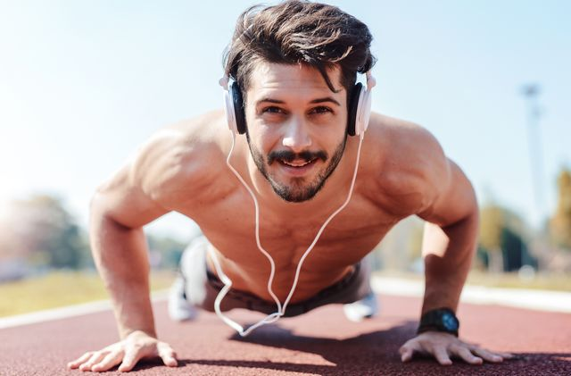 push ups young muscular sportsman doing fitness exercise outdoors sport, fitness, street workout concept