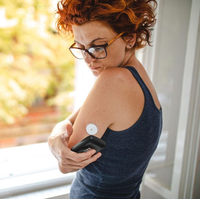 putting reader device over it to see the current blood sugar level