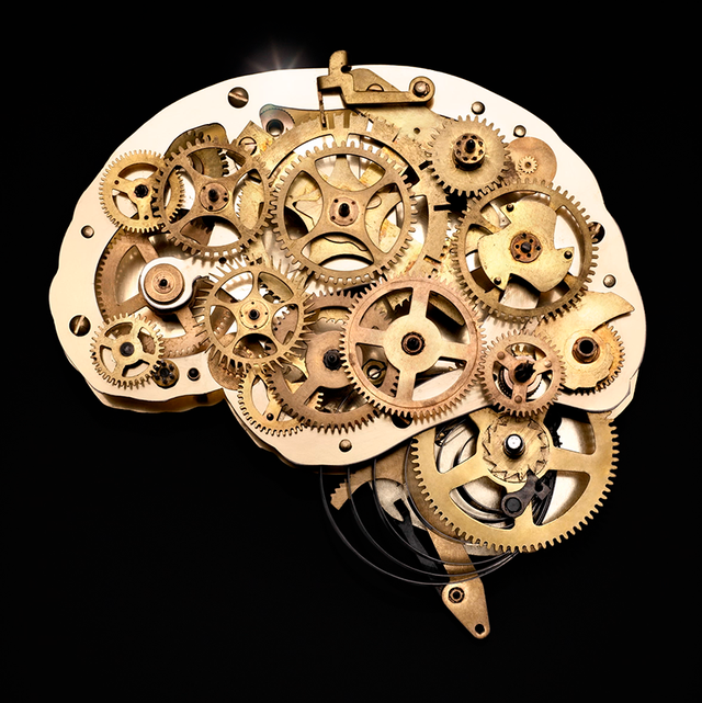 gold gears that create a brain on black background
