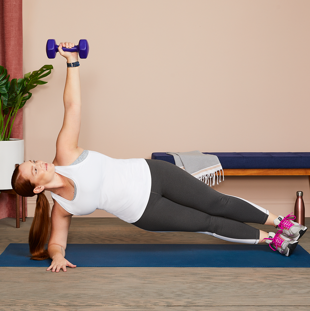 woman doing weighted side plank