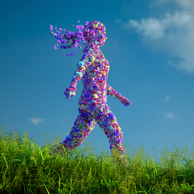 woman made of flowers walking through grass with blue sky