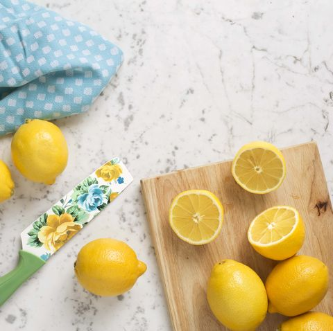 lemons on cutting board with floral knife