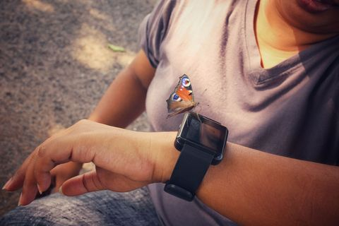 smartwatch with butterfly on hand