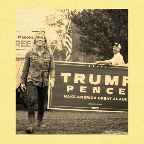 marjorie taylor greene in front of trump pence sign