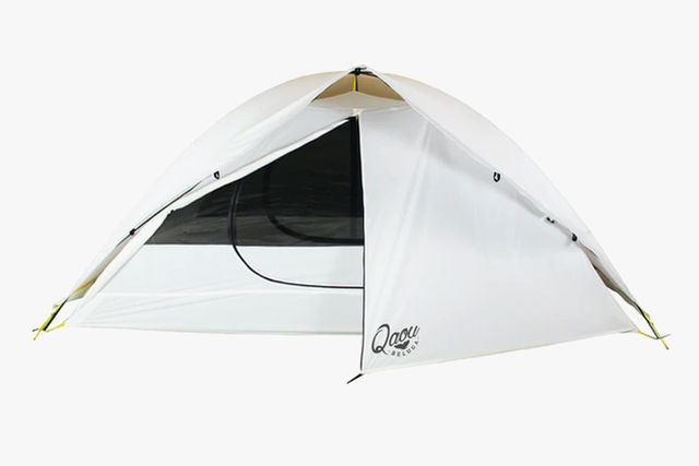 a white tent with a half open door