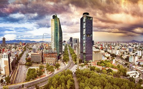 panoramic aerial view of mexico city skyline at dusk