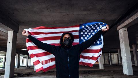 afroamerican man wearing hoodie and black facial mask anti racism concept