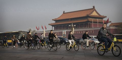 beijing, china   march 29 chinese commuters ride bike share through tiananmen square on march 29, 2017 in beijing, china the popularity of bike shares has exploded in the past year with more than two dozen providers now battling for market share in major cities across china  the bikes are hailed as an efficient, cheap, and environmentally friendly solution for commuters, where riders unlock the stationless bicycles using a mobile phone app, drop them anywhere for the next user, and spend as little as 1 yuan $015 per hour  given the bikes have several users a day   some of them inexperienced riders who swerve into traffic   they are often damaged, vandalized, or abandoned  companies like ofo routinely collect the battered two wheelers and bring them to a makeshift depot that is part repair shop, part graveyard where they are either salvaged or scrapped  the bike shares are powering a cycling revival of sorts in a country once known as the 'kingdom of bicycles'  in the early years of communist china, most chinese aspired to own a bicycle as a marker of achievement  when the country's economic transformation made cars a more valued status symbol, the bicycle   a chinese cultural icon   was mocked as a sign of backwardness  the bike share craze is also a boon for manufacturers who are now mass producing over a million bikes a month to meet demand, and the number of shared bike users will reach 50 million in china by the end of the year, according to beijing based bigdata research  not everyone is cheering the revival though, as municipal officials are drafting new regulations to control the chaotic flood of bicycles on streets and sidewalks   photo by kevin frayergetty images
