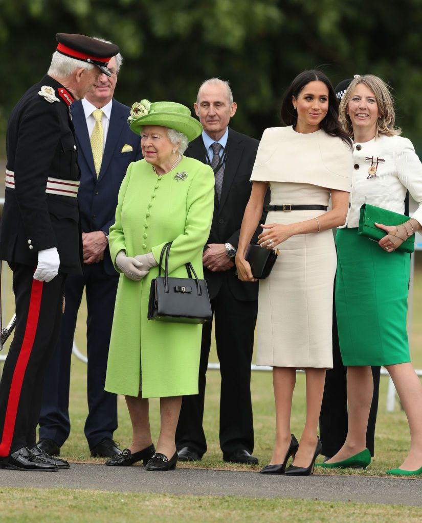 Meghan Markle Covers Shoulders In Structured Oat Coloured