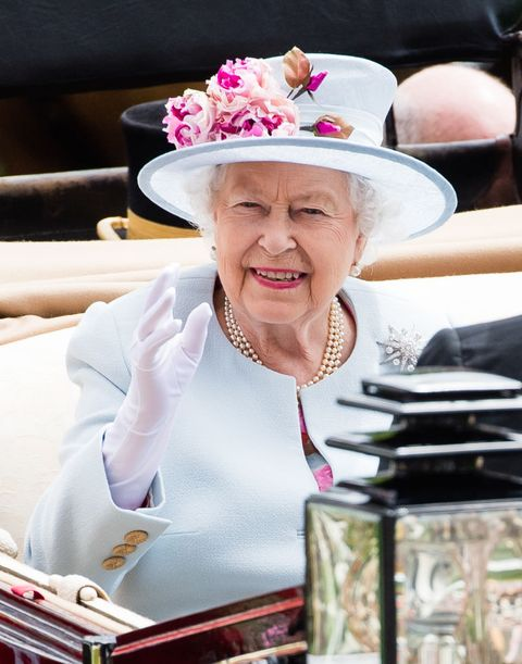 Facial expression, Hat, Pink, Fashion accessory, Sun hat, Headgear, Smile, Fun, Cowboy hat, Sitting,