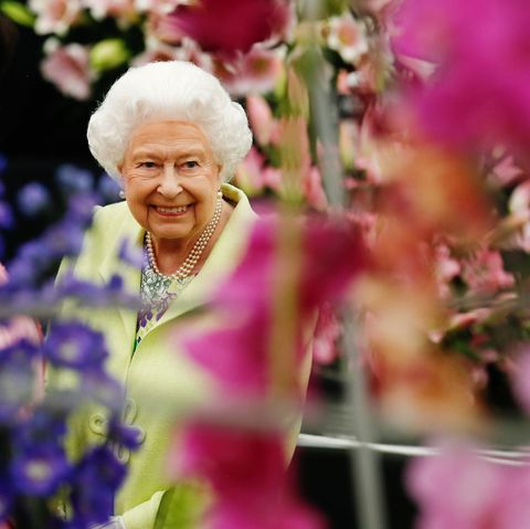 britain's queen elizabeth smiles as views flower displays in the great pavillion at the rhs chelsea flower show 2019, monday may 20, 2019 rhs  luke macgregor